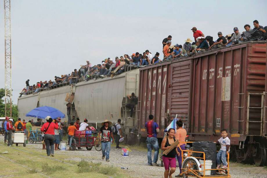 Central American immigrants risk it all and get on the so-called La Bestia (The Beast) cargo train in Arriaga, Chiapas state, Mexico,  in an attempt to reach the U.S. border. Photo: ELIZABETH RUIZ, Stringer / AFP