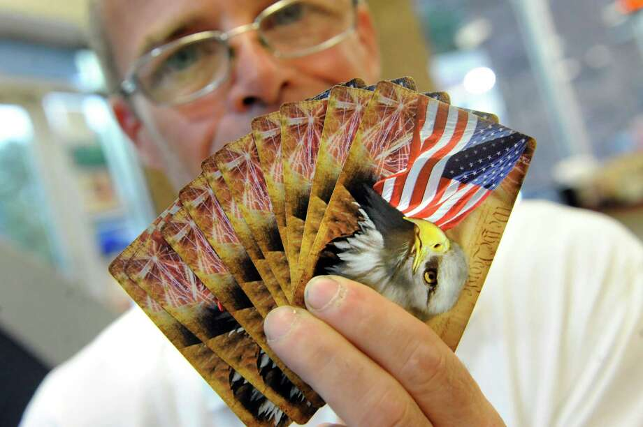 Jack Cox Jr., former Troy mayoral candidate, shows a hand of Constitution Cards on Wednesday July 2, 2014, Troy, N.Y. (Cindy Schultz / Times Union) Photo: Cindy Schultz / 00027614A