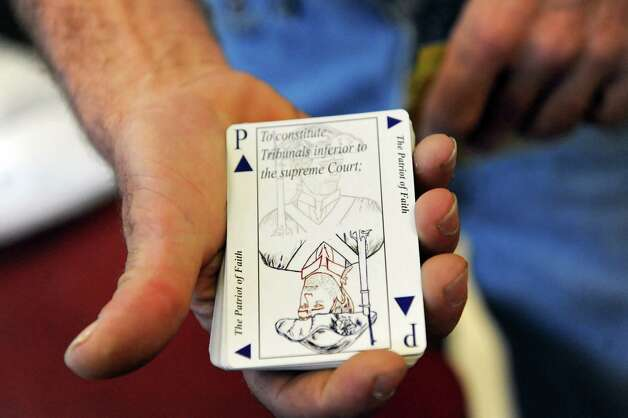 Jack Cox Jr., former Troy mayoral candidate, shows a face card from a deck of Constitution Cards on Wednesday July 2, 2014, Troy, N.Y. (Cindy Schultz / Times Union) Photo: Cindy Schultz / 00027614A