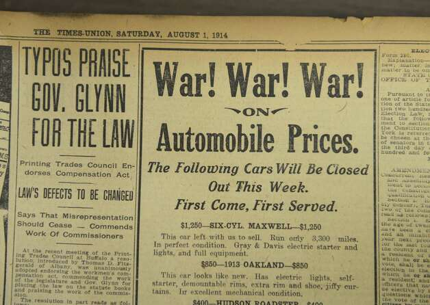 An ad in the August 1, 1914 editions of the Times Union calls for war on automobile prices Thursday, July 31, 2014, at the Times Union in Colonie, N.Y. WWI started July 28, 1914.  (Will Waldron/Times Union) Photo: WW