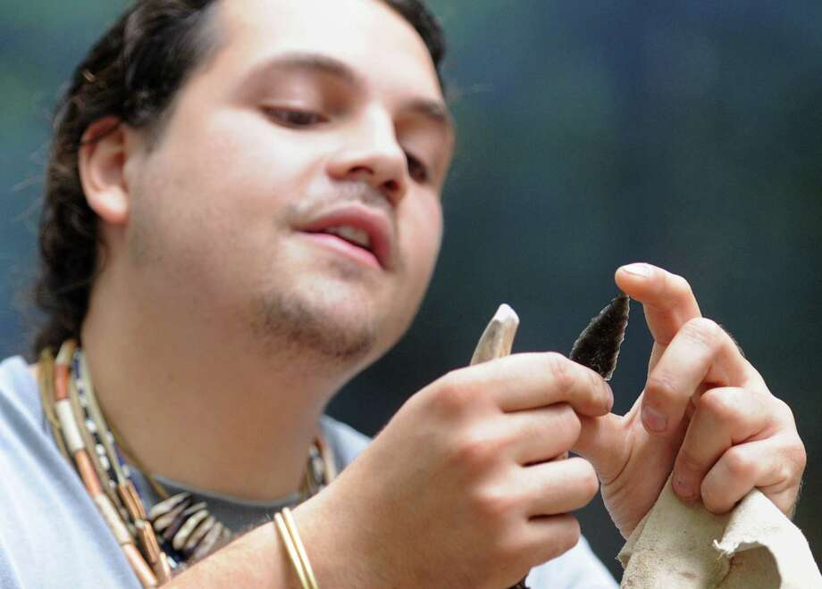 Brookfield's Drew Shuptar-Rayvis, of Accomac/Pocomoke descent, gives a tool-making demonstration at the 10th annual Green Corn Festival at the Institute for American Indian Studies in Washington, Conn. Saturday, Aug. 2, 2014.  The festival welcomed the first corn of the season and celebrated American Indian heritage and culture with music, dance, demonstrations, crafts, storytelling and food. Photo: Tyler Sizemore / The News-Times
