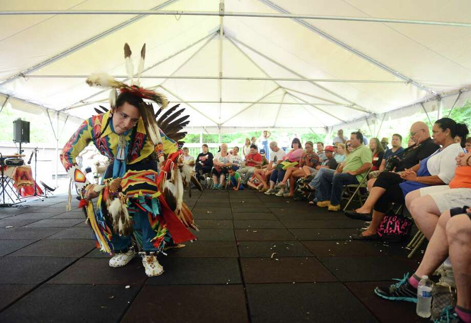 Garry Meeches, 16, of Waterford, performs a Northern Traditional dance at the 10th annual Green Corn Festival at the Institute for American Indian Studies in Washington, Conn. Saturday, Aug. 2, 2014.  The festival welcomed the first corn of the season and celebrated American Indian heritage and culture with music, dance, demonstrations, crafts, storytelling and food. Photo: Tyler Sizemore / The News-Times