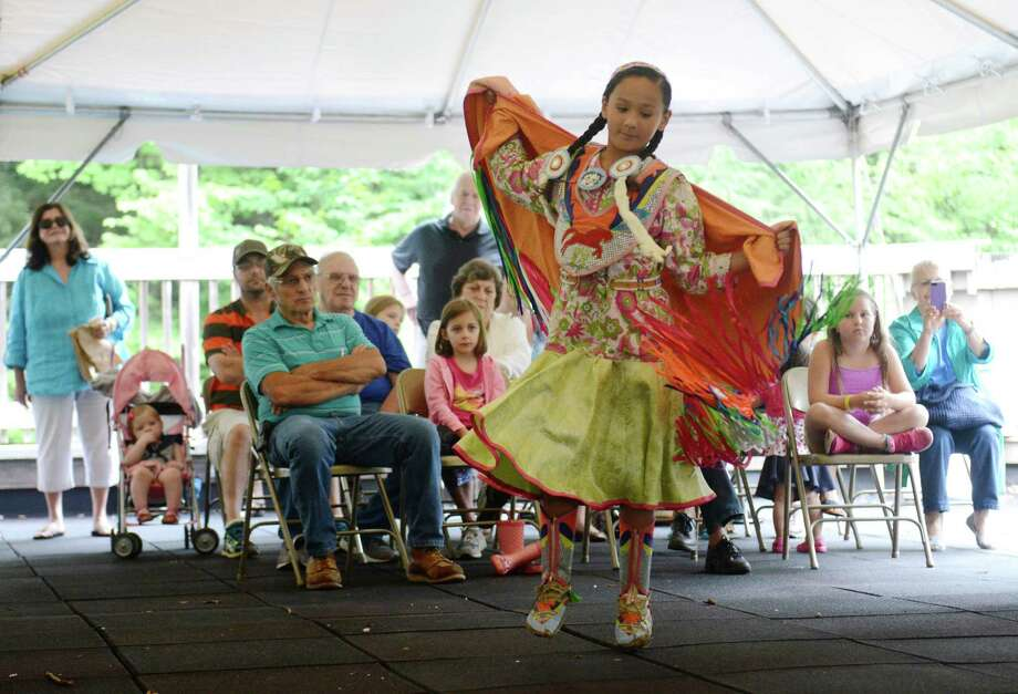Mayiki Plainbull, 9, of Norwich, performs a traditional dance at the 10th annual Green Corn Festival at the Institute for American Indian Studies in Washington, Conn. Saturday, Aug. 2, 2014.  The festival welcomed the first corn of the season and celebrated American Indian heritage and culture with music, dance, demonstrations, crafts, storytelling and food. Photo: Tyler Sizemore / The News-Times