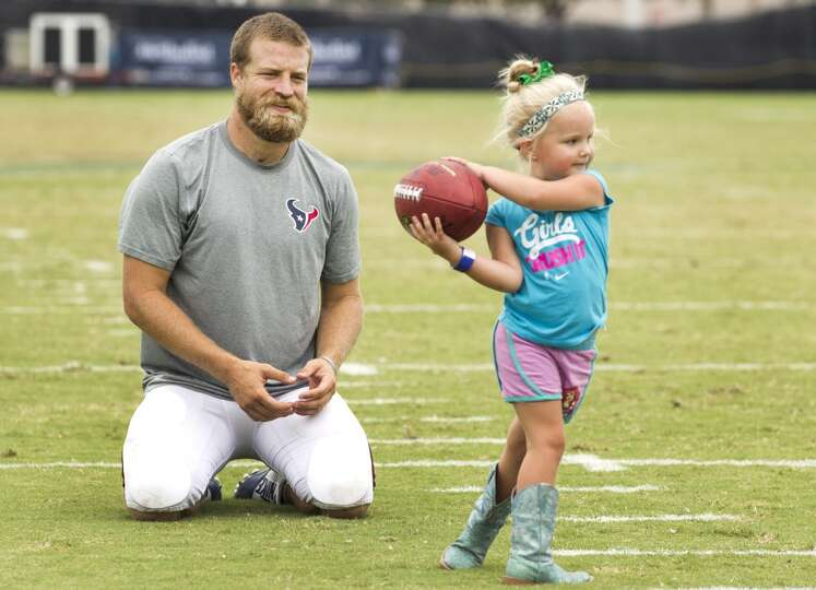 Texans quarterback Ryan Fitzpatrick, left, plays catch with his daughter, Lucy, after practice.