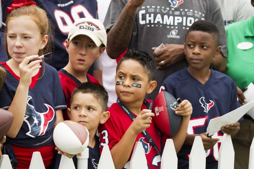 Texans fans wait for players to sign autographs.