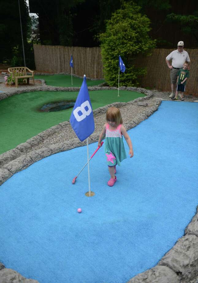 Stella Frosch, 3, of Brookfield, plays at the mini golf course at Valley Golf Center in New Milford, Conn. Friday, Aug. 1, 2014.  Steve's Deli recently opened beside Valley Golf Center and the two businesses feed off each other's customers to improve business. Photo: Tyler Sizemore / The News-Times