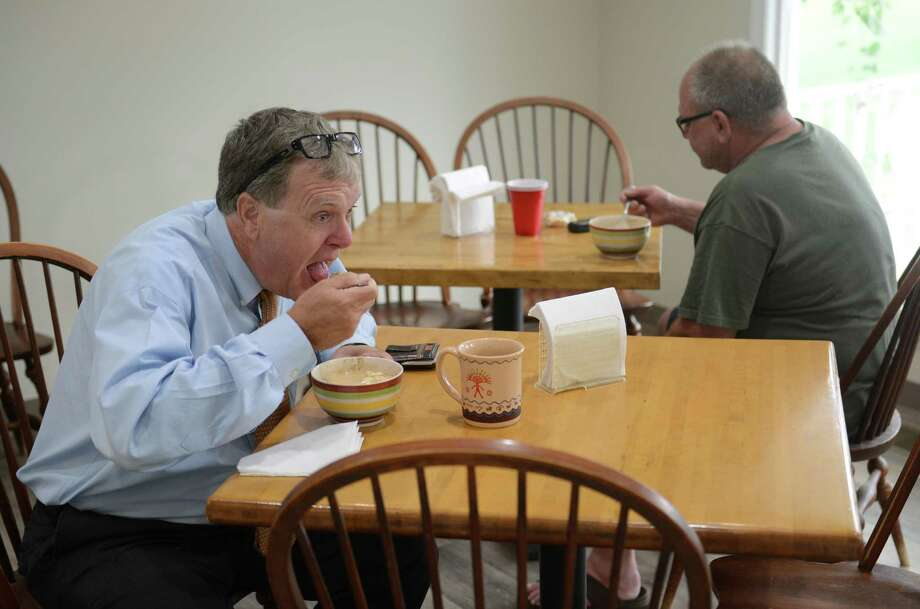 Torrey Smith, left, of Pawling, N.Y., and Carl Pozvek, of New Milford, eat clam chowder at Steve's Deli in New Milford, Conn. Friday, Aug. 1, 2014.  Steve's Deli recently opened beside Valley Golf Center and the two businesses feed off each other's customers to improve business. Photo: Tyler Sizemore / The News-Times