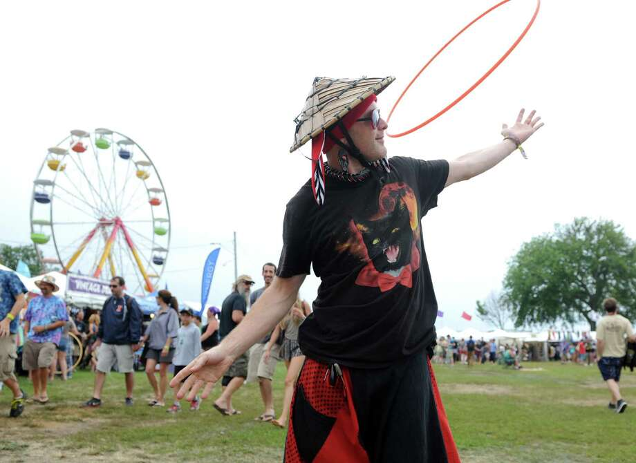 Al Rowe, of Boston, Mass. spins his hoola hoop at the annual Gathering of the Vibes music festival Saturday, Aug. 2, 2014, at Seaside Park in Bridgeport, Conn. Photo: Autumn Driscoll / Connecticut Post freelance