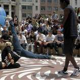 Oakland was rated as the fourth most liberal city. (Pictured: Hip-hop dancers entertain the crowds attending the 14th annual Art and Soul Festival.)