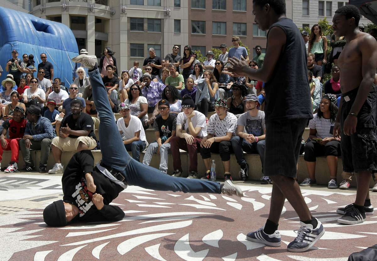 Hip-hop dancers entertain the crowds attending the 14th annual Art and Soul Festival in Oakland, Calif. on Saturday, Aug. 2, 2014. The two-day music and arts street fair concludes Sunday.
