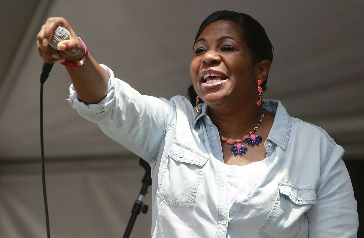 Renee Winston encourages the crowd at the Gospel Stage during the 14th annual Art and Soul Festival in Oakland, Calif. on Saturday, Aug. 2, 2014. The two-day music and arts street fair concludes Sunday.
