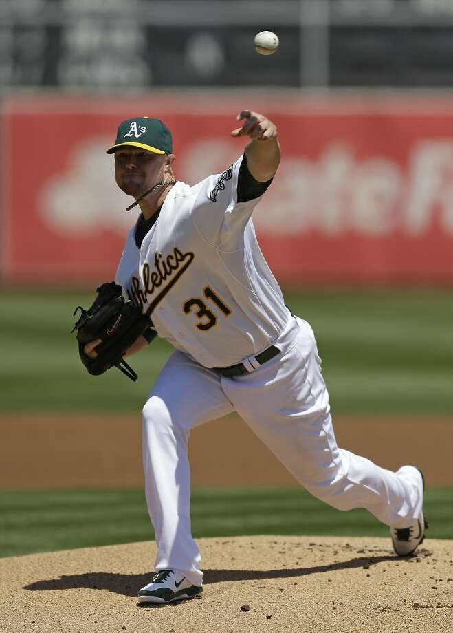 Jon Lester got the win after the A's put up eight runs in the fifth inning. Photo: Ben Margot, Associated Press