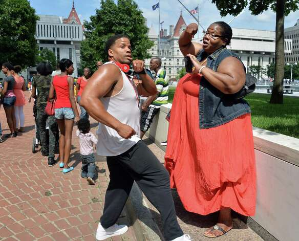 Antonio Saunders, left, and Jenell Paul, both of Albany, dance during the New York Statea€™s 2014 African American Family Day at the Empire State Plaza Saturday August 2, 2014, in Albany, NY.  (John Carl D'Annibale / Times Union) Photo: John Carl D'Annibale / 00027122A