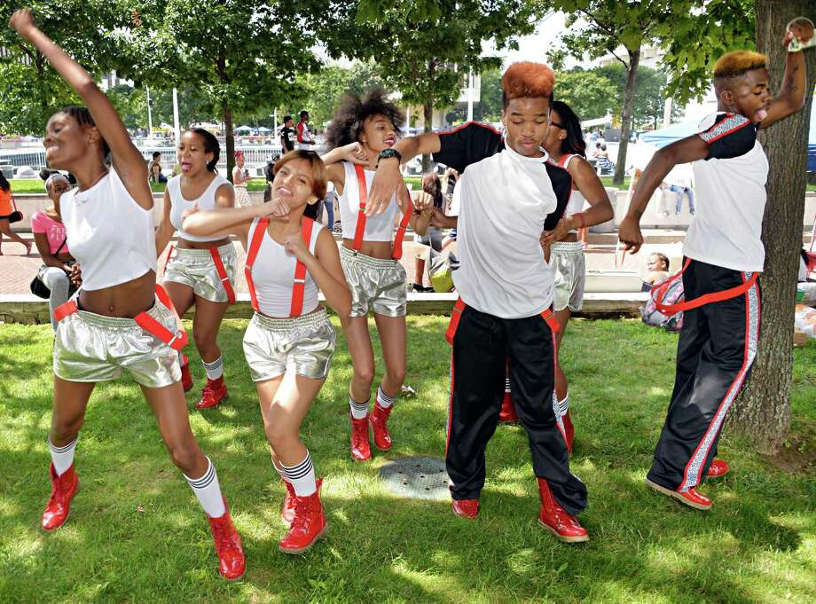 Dancers from Team Onyx of Albany warm up at the New York StateOs 2014 African American Family Day at the Empire State Plaza Saturday August 2, 2014, in Albany, NY.  (John Carl D'Annibale / Times Union) Photo: John Carl D'Annibale / 00027122A