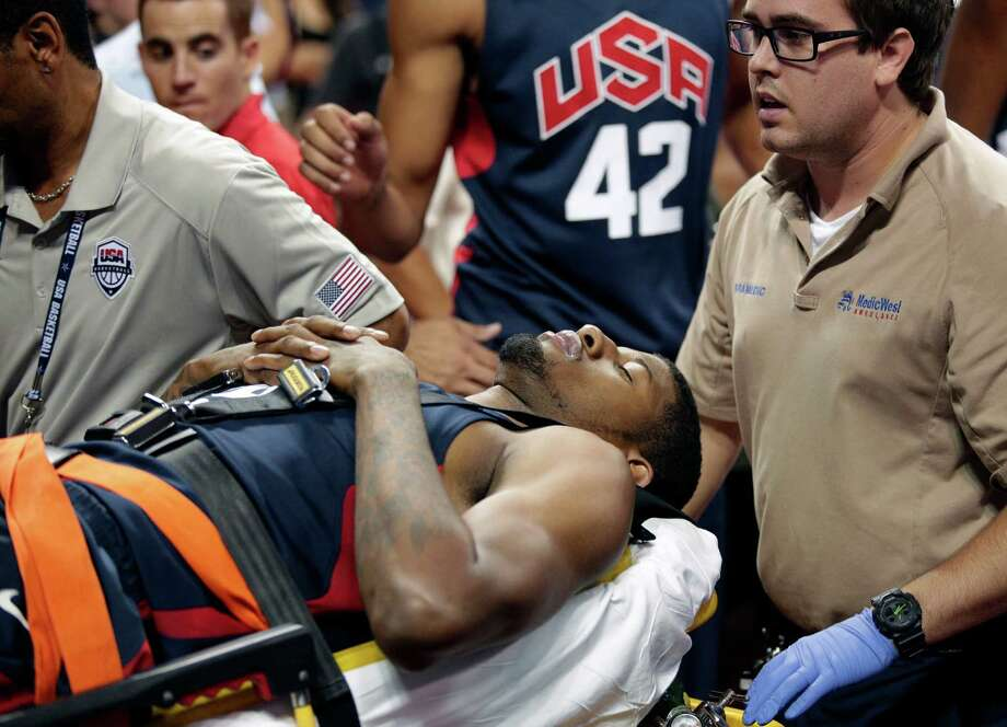 Indiana Pacers' Paul George is taken off the court after he was injured during the USA Basketball Showcase game Friday, Aug. 1, 2014, in Las Vegas. (AP Photo/John Locher) Photo: John Locher / Associated Press / AP