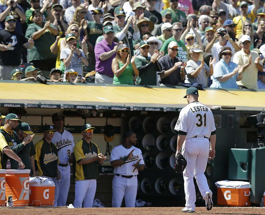 Jon Lester, who unlike most pitchers has no trouble meeting the 12-second rule, leaves to a standing ovation from A's fans. Photo: Ben Margot, Associated Press