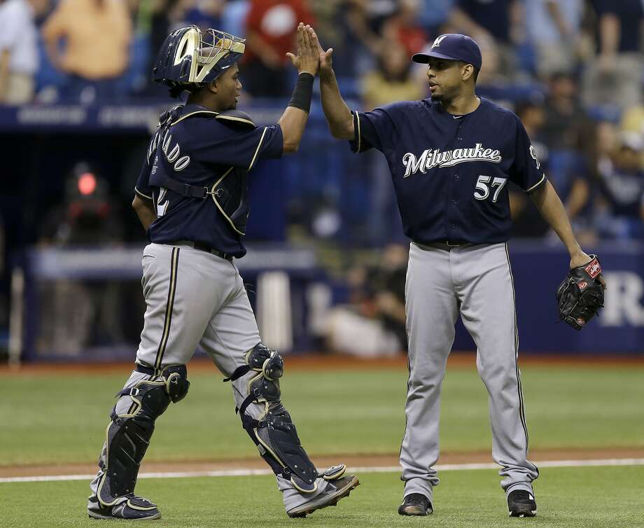 Closer Francisco Rodriguez, congratulated by catcher Martin Maldonado, is among many bright spots for the Brewers. Photo: Chris O'Meara, Associated Press