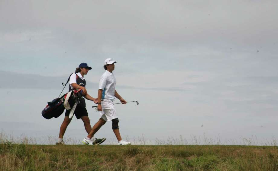 David Pastore, right, and his caddie, younger brother Paul Pastore, walk the course at The Creek in Locust Valley, N.Y. during Saturday's semifinals of the 112th Met Amateur. Photo: Contributed Photo, Metrropolitan Golf Association/C / Greenwich Time Contributed