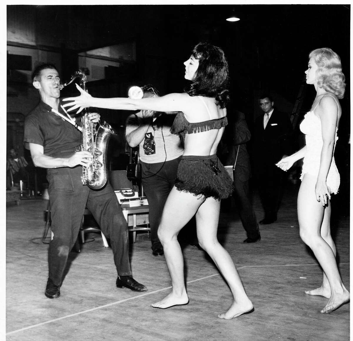 """In 1960, when she was 25, Candy Barr, right, taught actress Joan Collins to do a striptease for the movie """"Seven Thieves."""" She began dancing in her teens, and became a famous headliner at the Colony Club in downtown Dallas in the 1950s."""