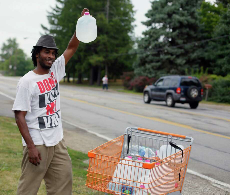 Isaac Miles bought water in Taylor, Mich., and brought it back to use and sell in Toledo, Ohio. Photo: Andy Morrison / The (Toledo) Blade / The Blade