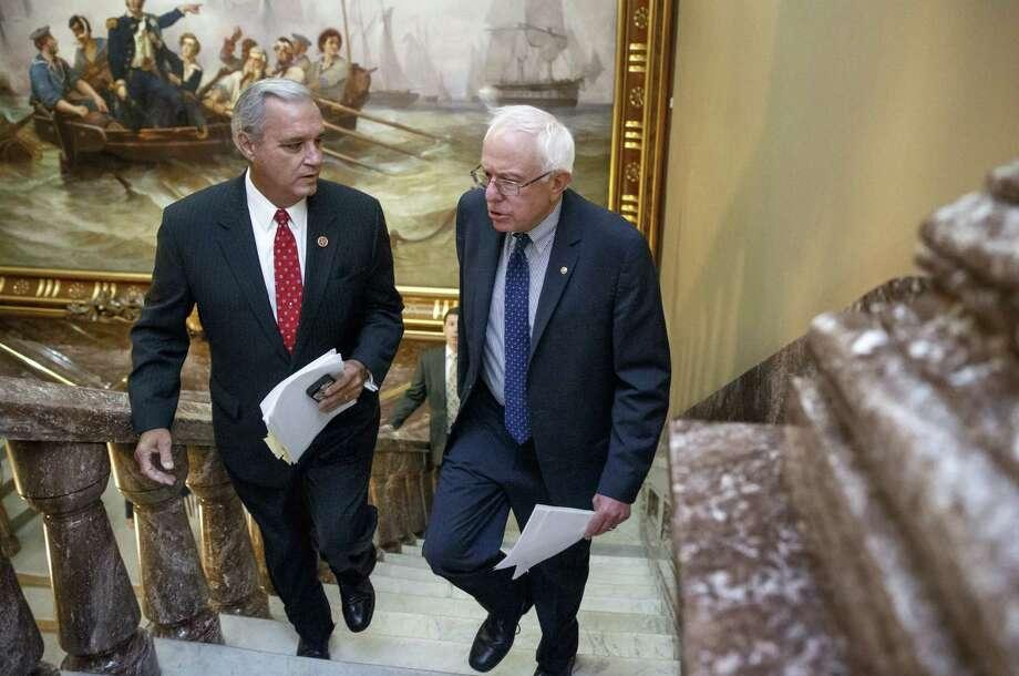 Sen. Bernie Sanders (right), I-Vt., and Rep. Jeff Miller, R-Fla., discuss veterans' health care on Capitol Hill. Photo: J. Scott Applewhite / Associated Press / AP
