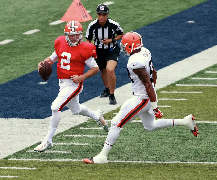 Cleveland Browns quarterback Johnny Manziel (2) runs out of bounds in front of Chris Kirksey at the NFL football team's training camp that was held at InfoCision Stadium in Akron, Ohio, Saturday Aug. 2, 2014. (AP Photo/Aaron Josefczyk) Photo: Aaron Josefczyk, FRE / FR171101 AP