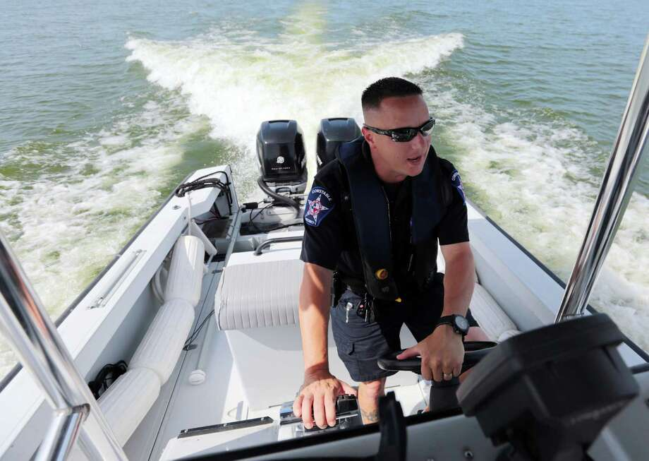 "Lt. Tim Cade is one of five Montgomery County constables patrolling Lake Conroe at any one time. ""We can add 30 officers and that still won't be enough,"" he said. Photo: Billy Smith II, Staff / © 2014 Houston Chronicle"