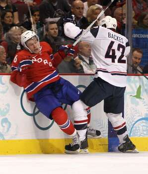 VANCOUVER, BC - FEBRUARY 18:  David Backes (#42) of the United States checks Jonas Holos of Norway into the boards during the ice hockey men's preliminary game between USA and Norway on day 7 of the 2010 Winter Olympics at Canada Hockey Place on February 18, 2010 in Vancouver, Canada.  (Photo by Bruce Bennett/Getty Images) *** Local Caption *** David Backes;Jonas Holos Photo: Bruce Bennett, Getty Images / 2010 Getty Images