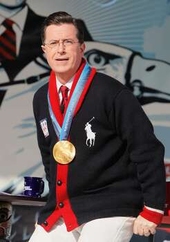 VANCOUVER, BC - FEBRUARY 18:  Comedian and talk show host Stephen Colbert reacts after putting on the Olympic gold medal won by United States Snowboard Cross athlete Seth Westcott while taping an episode of The Colbert Report at Creekside Park on February 18, 2010 in Vancouver, Canada.  (Photo by Kevin C. Cox/Getty Images) *** Local Caption *** Stephen Colbert Photo: Kevin C. Cox, Getty Images / 2010 Getty Images
