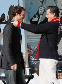 VANCOUVER, BC - FEBRUARY 18:  Comedian and talk show host Stephen Colbert (right) presents snowboard cross Olympian Seth Westcott of the United States with his Olympic gold medal while taping an episode of The Colbert Report at Creekside Park on February 18, 2010 in Vancouver, Canada.  (Photo by Kevin C. Cox/Getty Images) *** Local Caption *** Stephen Colbert;Seth Westcott Photo: Kevin C. Cox, Getty Images / 2010 Getty Images