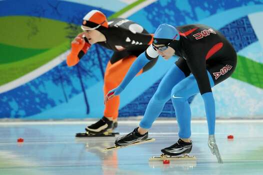 VANCOUVER, BC - FEBRUARY 18:  (L-R) Ireen Wust of Netherlands competes against Heather Richardson of the United States in the women's speed skating 10000 m final on day 7 of the Vancouver 2010 Winter Olympics at Richmond Olympic Oval on February 18, 2010 in Vancouver, Canada.  (Photo by Jasper Juinen/Getty Images) *** Local Caption *** Ireen Wust;Heather Richardson Photo: Jasper Juinen, Getty Images / 2010 Getty Images