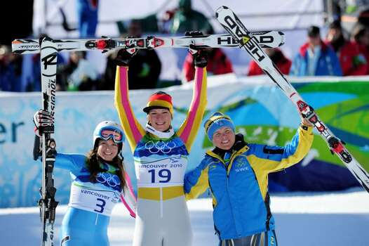 WHISTLER, BC - FEBRUARY 18:  (L-R) Julia Mancuso of The United States celebrates winning silver, Maria Riesch of Germany gold and Anja Paerson of Sweden bronze during the flower ceremony for the women's super combined downhill alpine skiing on day 7 of the Vancouver 2010 Winter Olympics at Whistler Creekside on February 18, 2010 in Whistler, Canada.  (Photo by Shaun Botterill/Getty Images) *** Local Caption *** Julia Mancuso;Maria Riesch;Anja Paerson Photo: Shaun Botterill, Getty Images / 2010 Getty Images