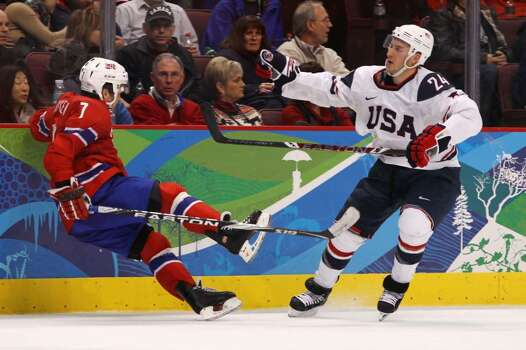 VANCOUVER, BC - FEBRUARY 18: Ryan Callahan (R) of the United States pushes down Tommy Jakobsen of Norway during the ice hockey men's preliminary game between USA and Norway on day 7 of the 2010 Winter Olympics at Canada Hockey Place on February 18, 2010 in Vancouver, Canada.  (Photo by Bruce Bennett/Getty Images) *** Local Caption *** Ryan Callahan;Tommy Jakobsen Photo: Bruce Bennett, Getty Images / 2010 Getty Images