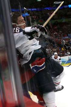 VANCOUVER, BC - FEBRUARY 18: Paul Stastny of the United States gets slammed against the boards during the ice hockey men's preliminary game between USA and Norway on day 7 of the 2010 Winter Olympics at Canada Hockey Place on February 18, 2010 in Vancouver, Canada.  (Photo by Bruce Bennett/Getty Images) *** Local Caption *** Paul Stastny Photo: Bruce Bennett, Getty Images / 2010 Getty Images