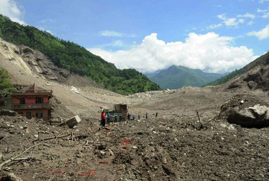 Nepalese rescue personnel examine the site of a landslide on the Sukoshi River northeast of Katmandu. Photo: Dipesh Shrestha / Getty Images / AFP