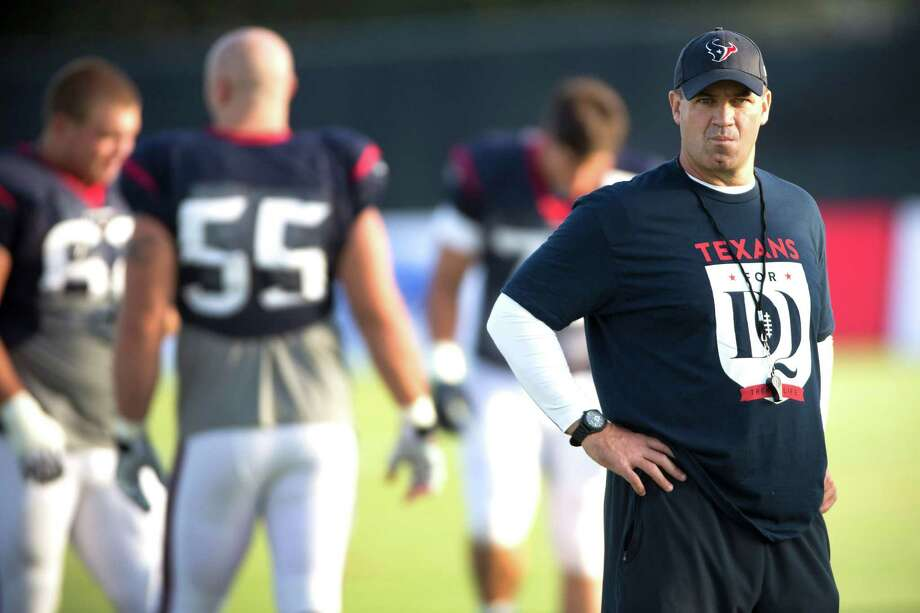 "Coach Bill O'Brien was among many at Saturday's Texans practice wearing a ""Texans for DQ"" shirt  - a show of support for tackle David Quessenberry, who is battling non-Hodgkin's lymphoma. Photo: Brett Coomer, Staff / © 2014 Houston Chronicle"