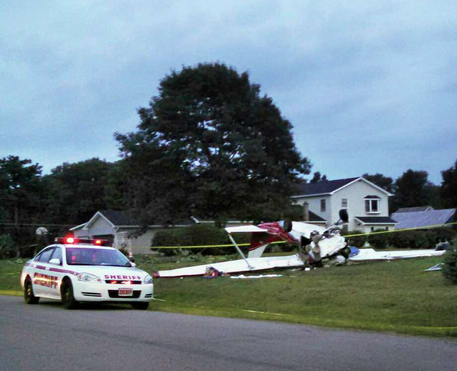 Scene of a small plane crash on Brownville Road that killed two men Saturday August 2, 2014, in Nothumberland, NY.   (Leigh Hornbeck / Times Union) Photo: Leigh Hornbeck