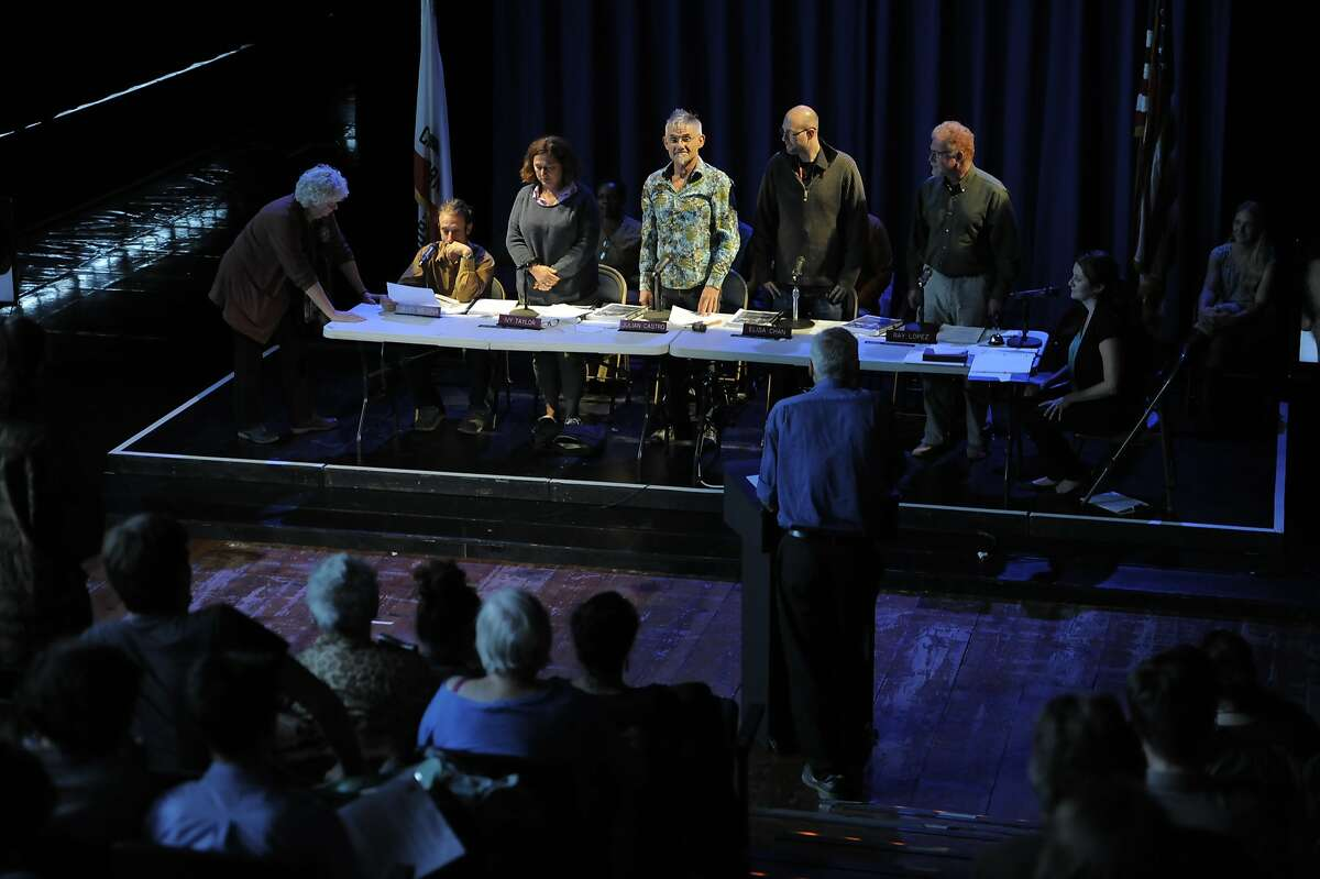 """A group of performers including Tom Dickson, center, as the Mayor, onstage during """"City Council Meeting"""" at Z Space on August 01, 2014 in San Francisco, CA. The cast consisted of members of the audience playing the City Council members as well as others addressing the council at a meeting covering pre-selected hot topics."""