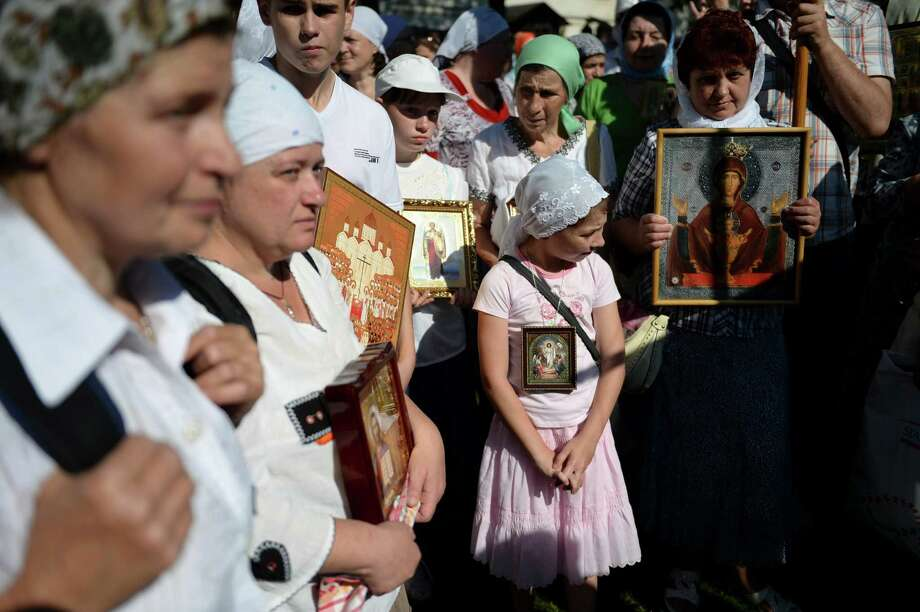 People gather before the start of their pilgrimage to the Trinity Lavra of St. Sergius on July 16 in Khotkovo, Russia. Birthday celebrations emphasized St. Sergius' role in shaping a unified Russia. Photo: JAMES HILL, STR / NYTNS
