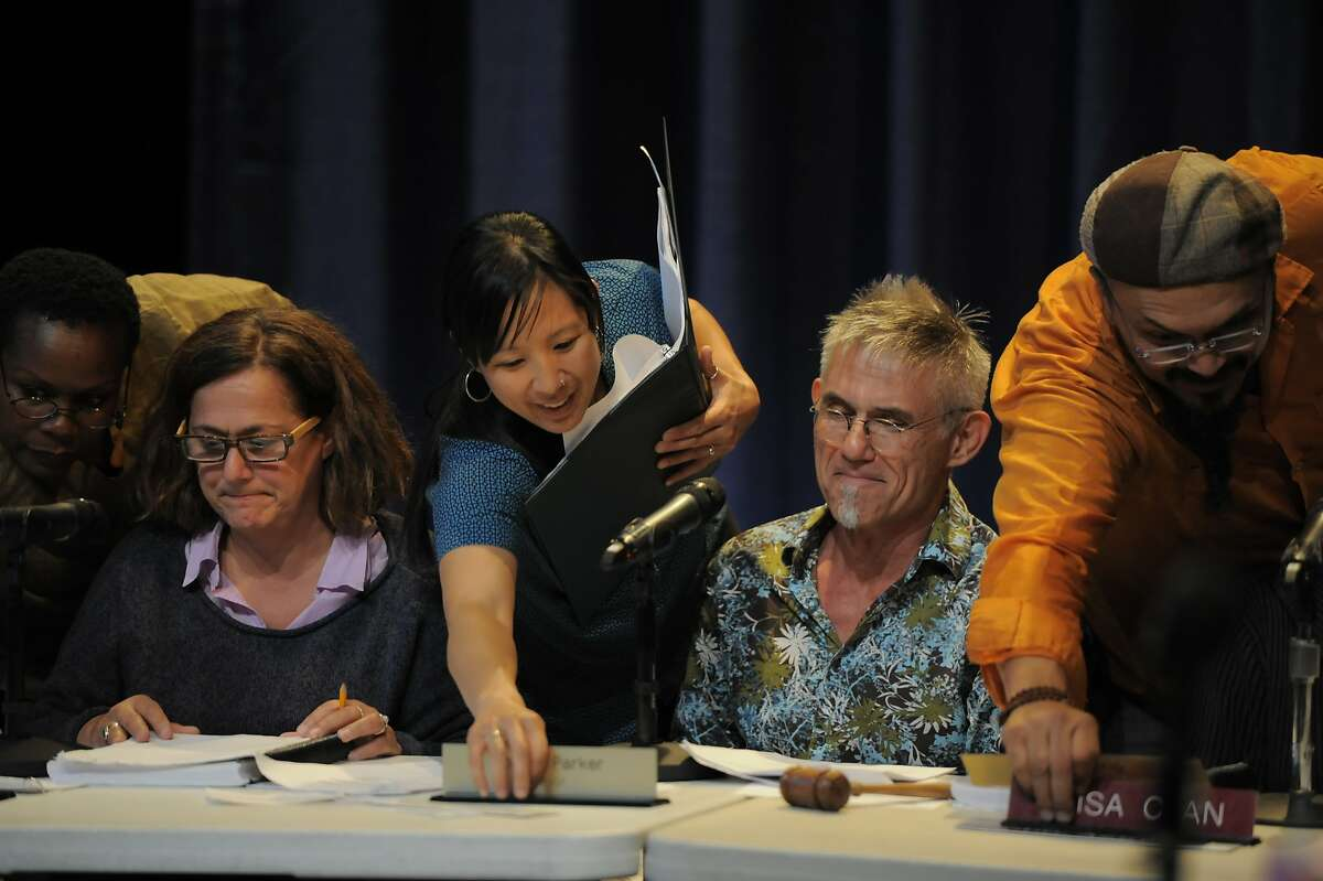 """Staff members including Awele (far left), Jennifer Chien (center), and Dwayne Calizo (right) facilitate the performance of """"City Council Meeting"""" at Z Space on August 01, 2014 in San Francisco, CA. The cast consisted of members of the audience, including Tom Dickson (second from right), who volunteered to play City Council members."""