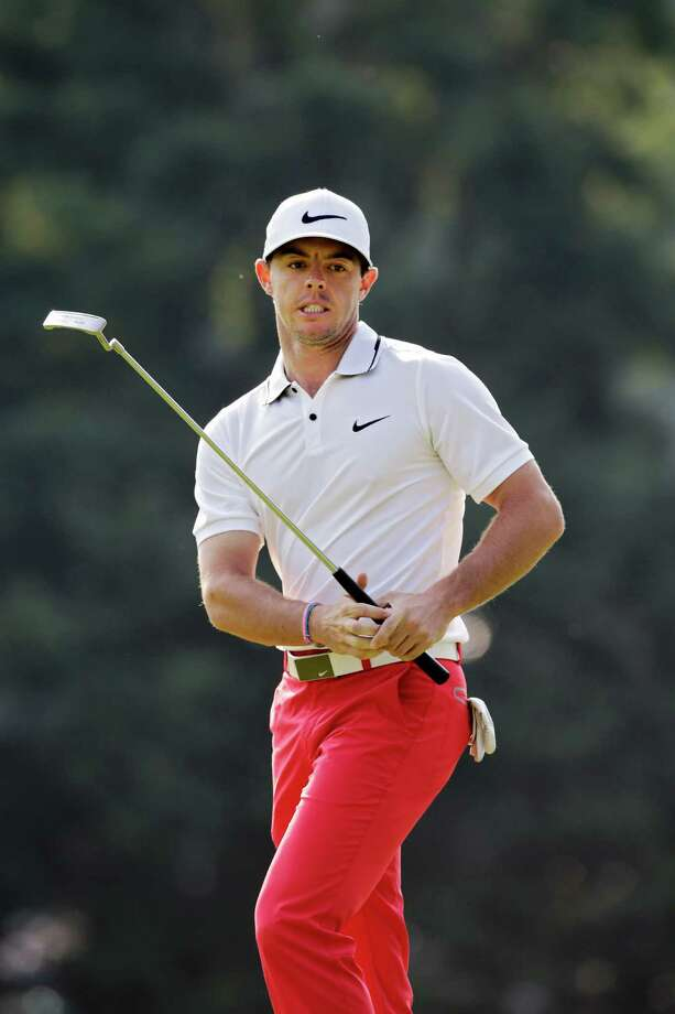 Rory McIlroy, from Northern Ireland, reacts after missing a birdie putt on the first green during the third round of the Bridgestone Invitational golf tournament Saturday, Aug. 2, 2014, at Firestone Country Club in Akron, Ohio. (AP Photo/Mark Duncan) ORG XMIT: OHMD115 Photo: Mark Duncan / AP