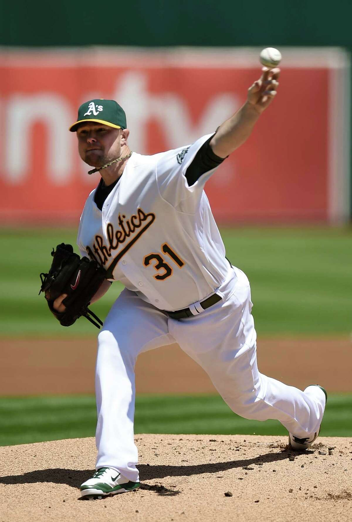OAKLAND, CA - AUGUST 02: Jon Lester #31 of the Oakland Athletics pitches against the Kansas City Royals in the top of the first inning at O.co Coliseum on August 2, 2014 in Oakland, California. (Photo by Thearon W. Henderson/Getty Images) ORG XMIT: 477587309
