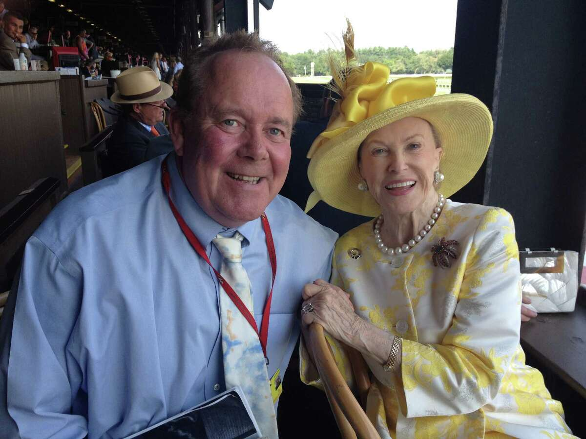 """""""It was Whitney Handicap Day at Saratoga Saturday, and it's not officially Whitney Day until the leading lady of the Spa City gets to her box seat at the finish line. Marylou Whitney, looking stunning in yellow, waved to fans on the apron and talked to anyone who dropped by the box. Even me. She and I chatted about her day as the guest handicapper in the Times Union."""" - Tim Wilkin, Aug. 2, 2014"""