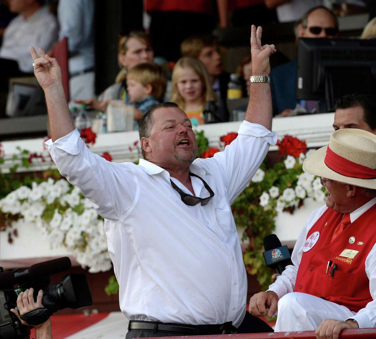 Trainer Eric Guillot is exultant after his charge Moreno won the 87th running of The Whitney Saturday afternoon Aug. 2, 2014 at the Saratoga Race Course in Saratoga Springs, N.Y. (Skip Dickstein/Times Union) ORG XMIT: NYALT