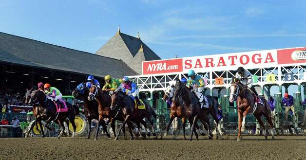 The field leaves the gate at the start of the 87th running of The Whitney Saturday afternoon Aug. 2, 2014 at the Saratoga Race Course in Saratoga Springs, N.Y.  (Skip Dickstein/Times Union) ORG XMIT: NYALT Photo: SKIP DICKSTEIN