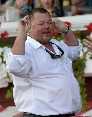Trainer Eric Guillot is exultant after his charge Moreno won the 87th running of The Whitney Saturday afternoon Aug. 2, 2014 at the Saratoga Race Course in Saratoga Springs, N.Y.  (Skip Dickstein/Times Union) ORG XMIT: NYALT Photo: SKIP DICKSTEIN