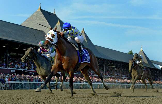 Moreno ridden by jockey Junior Alvarado outlasted the field to win the 87th running of The Whitney Saturday afternoon Aug. 2, 2014 at the Saratoga Race Course in Saratoga Springs, N.Y.  (Skip Dickstein/Times Union) ORG XMIT: NYALT Photo: SKIP DICKSTEIN