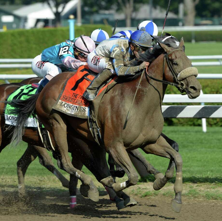 Sweet Reason with jockey Irad Ortiz Jr. wins the 89th running of The Test Stakes Saturday afternoon Aug. 2, 2014 at the Saratoga Race Course in Saratoga Springs, N.Y.  (Skip Dickstein/Times Union) ORG XMIT: NYALT Photo: SKIP DICKSTEIN