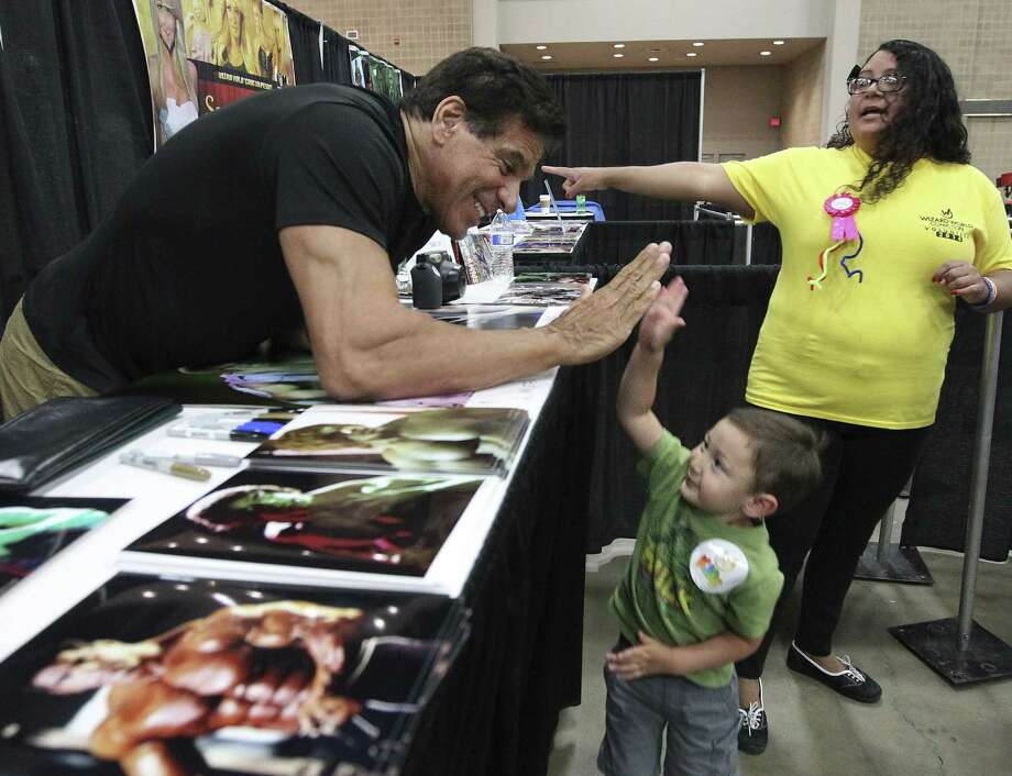 """Actor Lou Ferrigno, star of """"The Incredible Hulk,"""" offers a high five to perhaps a hulk in the making, 3-year-old Benjamin Togo of Schertz, at Wizard World San Antonio Comic Con at the Convention Center. Photo: Kin Man Hui, San Antonio Express-News / ©2014 San Antonio Express-News"""
