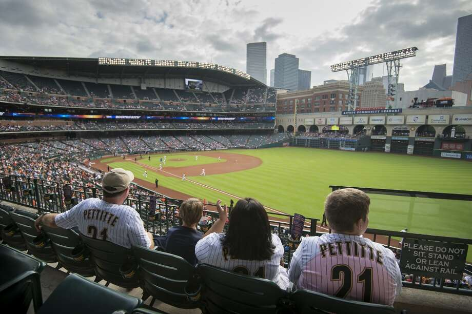 Astros fans cheer as their team takes the field to face the Toronto Blue Jays. Photo: Smiley N. Pool, Houston Chronicle